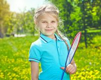 Girl with tennis racket Stock Image