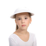 Girl in tennis top and hat Royalty Free Stock Images