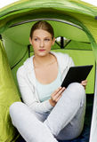 Girl in the tent with tablet Stock Image