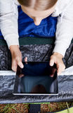 Girl in the tent with tablet Stock Photo