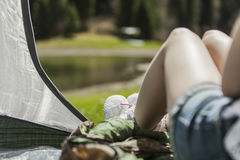 The girl in tent on vacation Royalty Free Stock Photography