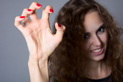 A girl with a terrible frightening hand Royalty Free Stock Images