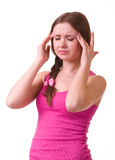 Girl with terrible headache holding head in pain Royalty Free Stock Images