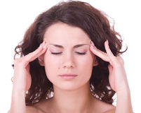Girl with terrible headache holding head in pain Stock Photo