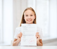 Girl with test and grade at school Royalty Free Stock Photo