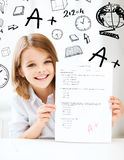 Girl with test and A grade at school Stock Image