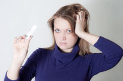 The girl with the test for pregnancy Stock Photography