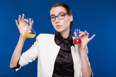 Girl with test tubes Royalty Free Stock Photo