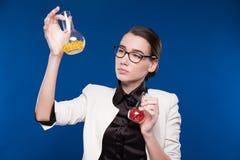 Girl with test tubes Stock Photos