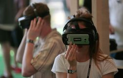 Girl testing Vr sets at sonar festival wide Stock Photos