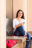 Girl  text message on the phone on the window of street coffee shop Royalty Free Stock Photos