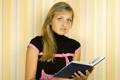 Girl with textbook Royalty Free Stock Photo
