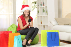 Girl texting greeting sms on mobile phone Royalty Free Stock Photo