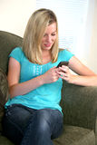 Girl texting on her cell phone Stock Image