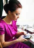 Girl texting on mobile phone. Beautiful girl texting on modern mobile phone Royalty Free Stock Photos