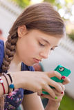 Girl texting on Phone Stock Images