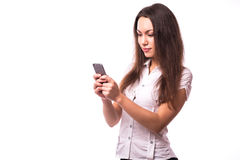 Girl texting  on phone. Office girl texting  on phone Royalty Free Stock Photos