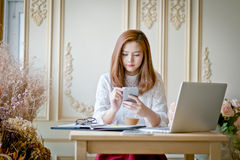 Girl texting on the  phone Stock Photos