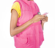 Girl texting with a pink phone Royalty Free Stock Photo
