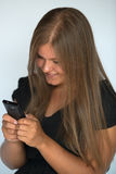 Girl, texting with smart phone Stock Images