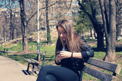 Girl Texting On The Smart Phone Stock Images