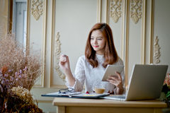 Girl texting on the tablet,With space for text ads. On the tip of her royalty free stock photo