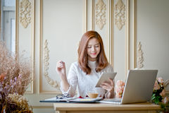 Girl texting on the tablet,With space for text ads. On the tip of her stock photography