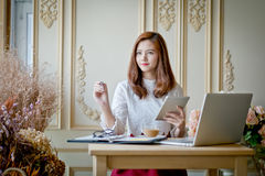 Girl texting on the tablet,With space for text ads. On the tip of her stock images