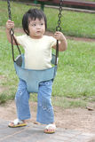 Girl on th swing, angry. Girl on the swing with angry face expression royalty free stock photography