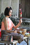 A girl with Thai instrument Royalty Free Stock Image