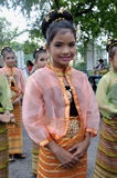 The Girl in Thai Traditional Dress. BANGKOK, THAILAND - OCTOBER 3: Thai Traditional Dress. This is the parade of making traditional merit of people from the royalty free stock photos