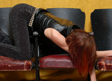Girl on theatre seats 2. This woman can sleep anywhere Royalty Free Stock Image