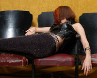 Girl on theatre seats 5. This woman can sleep anywhere stock image