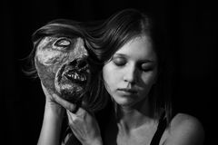 Girl with a theatrical mask in his hands Stock Photos