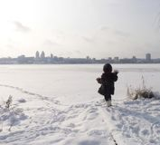 Girl at thebank of frozen river Stock Photo
