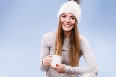 Girl in thermal underwear drinking tea Stock Photos
