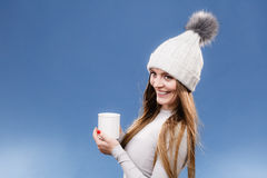 Girl in thermal underwear drinking tea Royalty Free Stock Photos