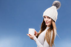 Girl in thermal underwear drinking tea Stock Images