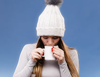 Girl in thermal underwear drinking tea Royalty Free Stock Images