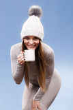 Girl in thermal underwear drinking tea Royalty Free Stock Photo