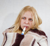 Girl with a thermometer Stock Image