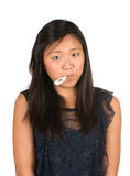 Girl With Thermometer In Her Mouth Royalty Free Stock Photos