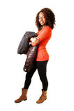 Girl in thighs holding jacket. Royalty Free Stock Images