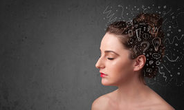 girl thinking with abstract icons on her head Royalty Free Stock Images