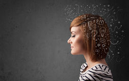 Girl thinking with abstract icons on her head Royalty Free Stock Photography