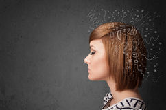 Girl thinking with abstract icons on her head Stock Images