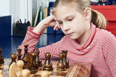 Girl thinking in chess game Royalty Free Stock Photography