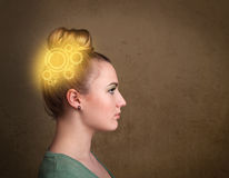 Girl thinking with a glowing machine head. Clever girl thinking with a glowing machine head illustration Stock Images