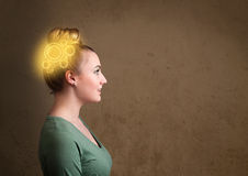 Girl thinking with a glowing machine head illustration. Clever girl thinking with a glowing machine head illustration stock image