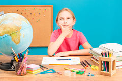 Girl thinking about her homework Stock Photos